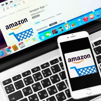 33913733 - simferopol, russia - november 22, 2014:  amazon application on apple iphone 6 and macbook display. amazon is an american international electronic commerce company